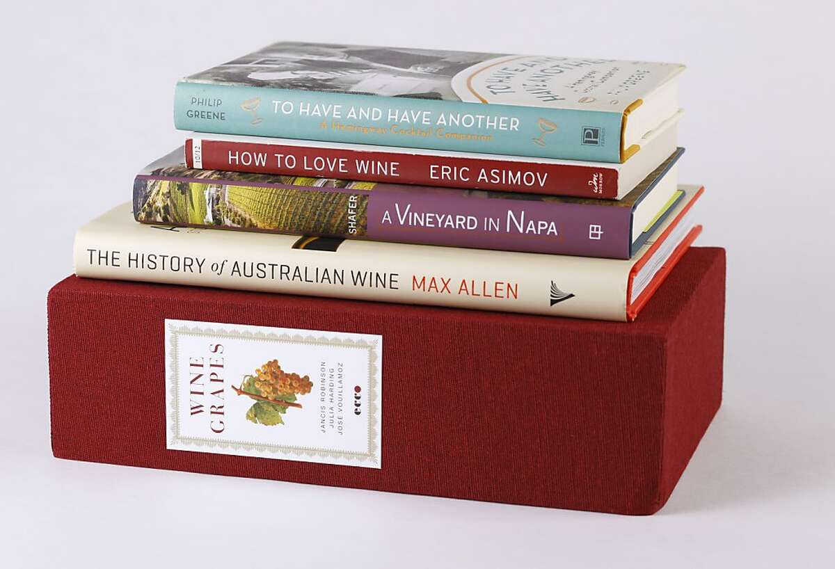 """Books: """"To Have and Have Another,"""" by Philip Greene, """"How to Love Wine,"""" by Eric Asimov, """"A Vineyard in Napa,"""" by Doug Shafer, """"The History of Australia Wine,"""" by Max Allen, """"Wine Grapes,"""" by Jancis Robinson, Julia Harding and Jose Vouillamoz. as seen in San Francisco, California on Wednesday, October 31, 2012."""