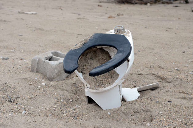 A toilet washed onto the beach from the bath house at Cove Island Beach in Stamford on Thursday, Nov. 1, 2012. Photo: Amy Mortensen / Stamford Advocate Freelance