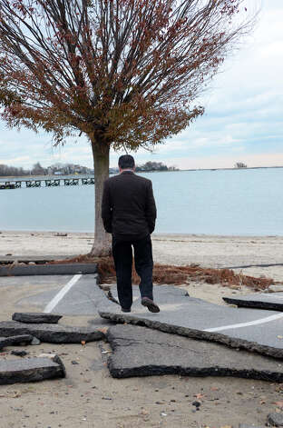 Stamford Mayor Michael Pavia surveys the damage to West Beach in Stamford on Thursday, Nov. 1, 2012. Photo: Amy Mortensen / Stamford Advocate Freelance