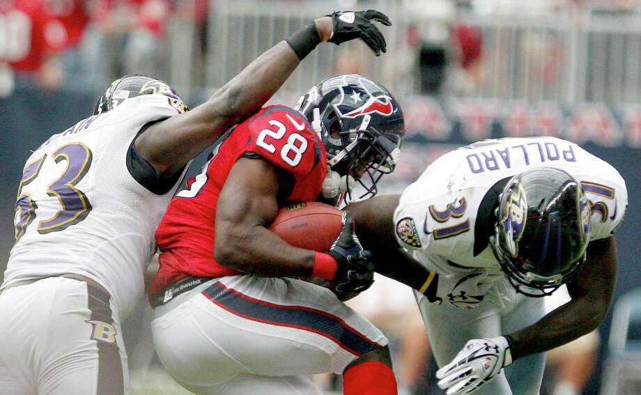 Justin Forsett #28 of the Houston Texans is tackled by Jameel McClain #53 of the Baltimore Ravens and Bernard Pollard #31 of the Baltimore Ravens on October 21, 2012 at Reliant Stadium in Houston, Texas. Texas won 43 to 13. Photo: Thomas B. Shea, Getty Images / 2012 Getty Images