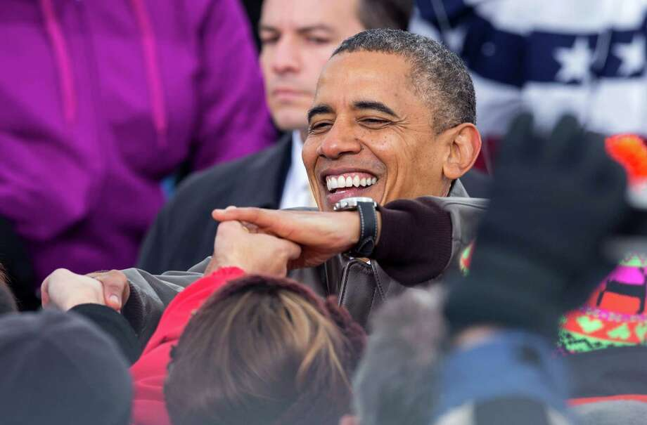 President Barack Obama shakes hands with supporters during a campaign stop at Austin Straubel International Airport in Green Bay, Wis.,Thursday, Nov. 1, 2012.  (AP Photo/Tom Lynn) Photo: Tom Lynn, FRE / FR170717 AP