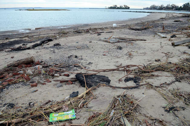 Bricks and other debris washed up at Cove Island Beach in Stamford on Thursday, Nov. 1, 2012. Photo: Amy Mortensen / Stamford Advocate Freelance