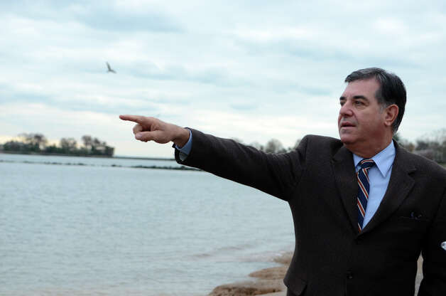 Stamford Mayor Michael Pavia points to the estuary as he surveys the damage to Cove Island Beach in Stamford on Thursday, Nov. 1, 2012. Photo: Amy Mortensen / Stamford Advocate Freelance