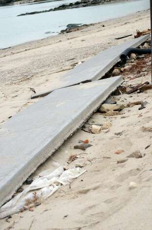 The West Beach sidewalk in Stamford rests in pieces on Thursday, Nov. 1, 2012. Photo: Amy Mortensen / Stamford Advocate Freelance