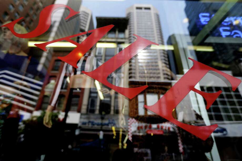 In this Wednesday, Oct. 17, 2012,  photo, a sign advertising a sale is seen posted on a storefront in Philadelphia. A flurry of reports released Thursday, Nov. 1, 2012, showed that U.S. consumers are growing more confident and spending more, boosting a still-weak economy just five days before the presidential election. Consumer confidence surged in October to its highest level in nearly five years. Americans were encouraged by recent declines in the unemployment rate. And they responded by spending more on cars and trucks, at retail businesses and on goods produced at U.S. factories.  (AP Photo/Matt Rourke) Photo: Matt Rourke, STF / AP