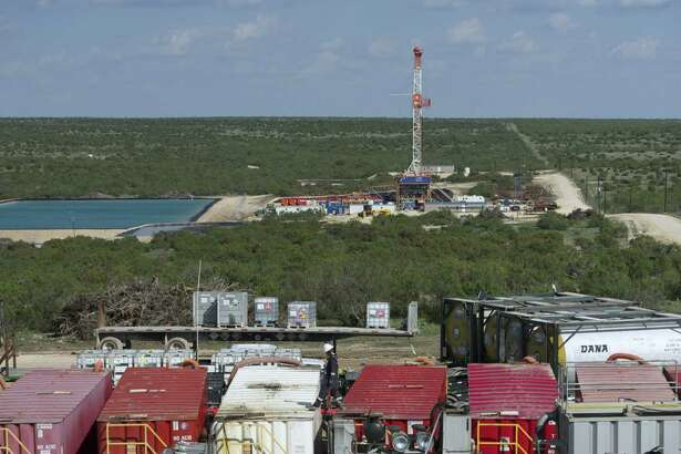 Workers and equipment conduct a hydraulic fracturing job in Texas' Permian Basin. (Apache/file photo)