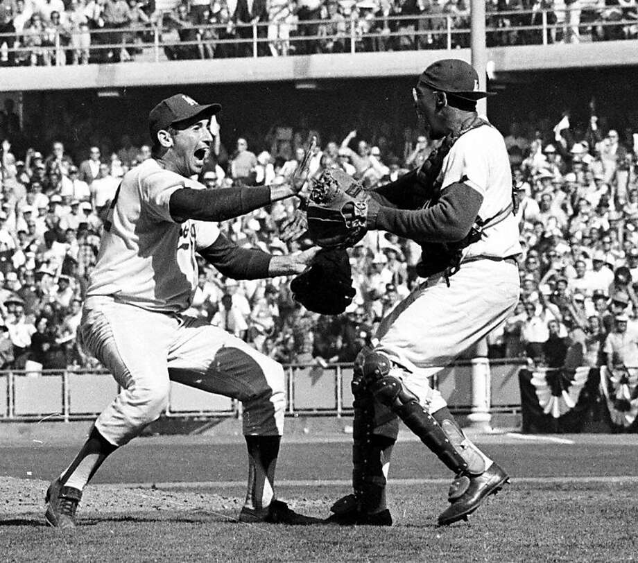 Sandy Koufax (left), shown celebrating with catcher John Roseboro after nailing down the '63 World Series, was simply the best pitcher of his era. Photo: AP