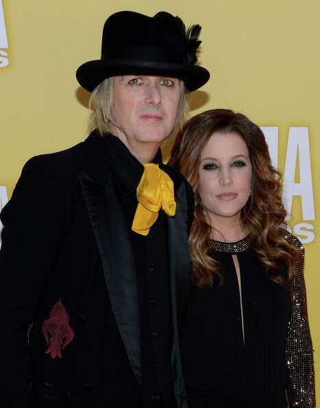 Lisa Marie Presley (R) and Michael Lockwood attend the 46th annual CMA Awards at the Bridgestone Are