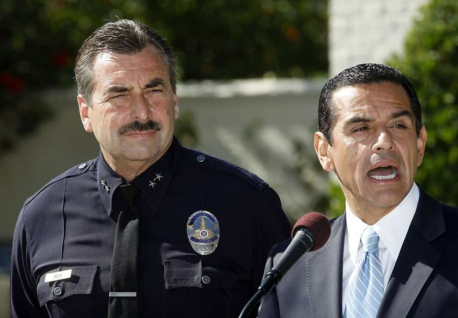 Charlie Beck is introduced as chief of the Los Angeles Police Department by Mayor Antonio Villaraigosa. Photo: Damian Dovarganes, AP