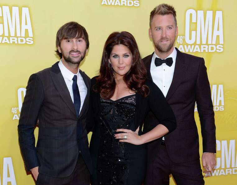 (L-R) Dave Haywood, Hillary Scott and Charles Kelley of Lady Antebellum attend the 46th annual CMA A