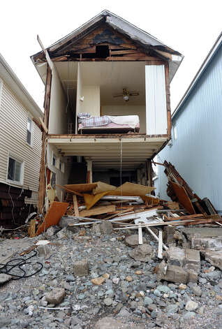 A beach front home was sheared in half because of Hurricane Sandy on Hillside Avenue in Milford, Conn. on Thursday November 1, 2012. Photo: Christian Abraham / Connecticut Post