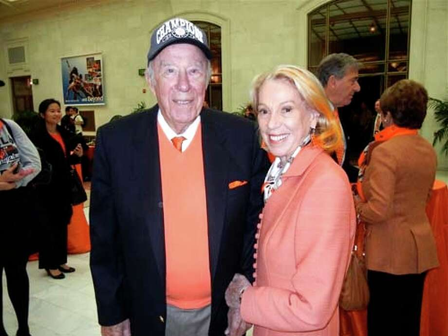 Former Sec. of State George Shultz and his missus, Protocol Chief Charlotte Shultz, who dyed her coiffure orange for the occasion (Catherine Bigelow)
