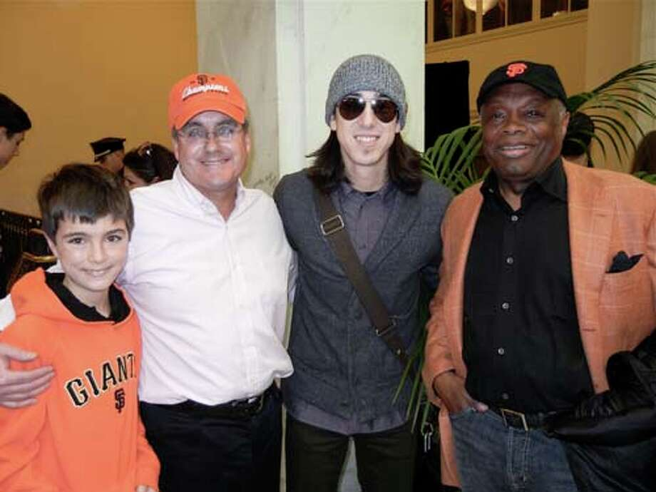 Declan Herrera (left) with his dad, City Attorney Dennis Herrera, Giants pitcher Tim Lincecum and Willie Brown (Catherine Bigelow)