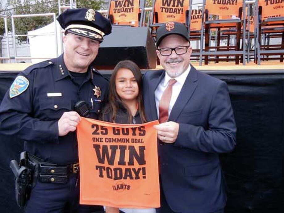 SFPD Chief Greg Suhr (left) with Katherine Henkle-Kawa and her dad, Mayoral Chief of Staff Steve Kawa (Catherine Bigelow)