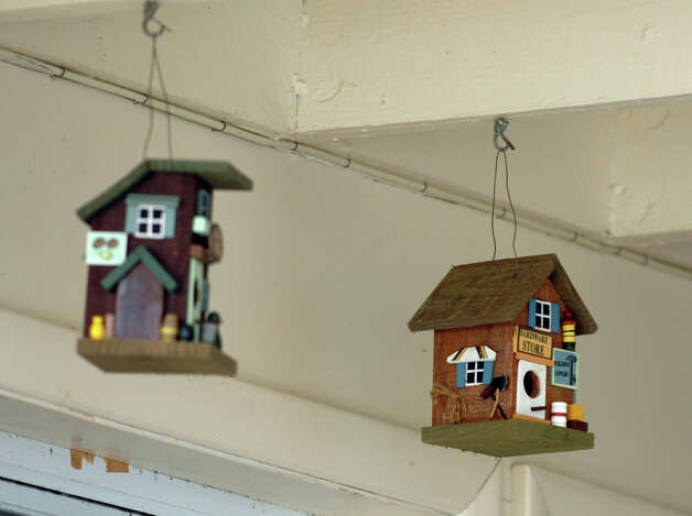 Decorative bird houses hang with no damage even though the house they were in was sheared in half as a result of Hurricane Sandy on Hillside Avenue in Milford, Conn. on Thursday November 1, 2012. Photo: Christian Abraham / Connecticut Post
