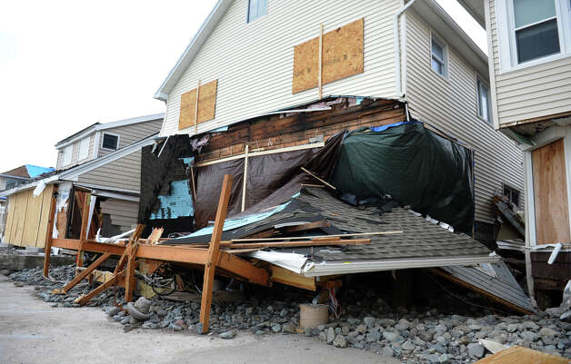 Clean up is underway from damage from Hurricane Sandy to homes along Hillside Avenue in Milford, Conn. on Thursday November 1, 2012. Photo: Christian Abraham / Connecticut Post