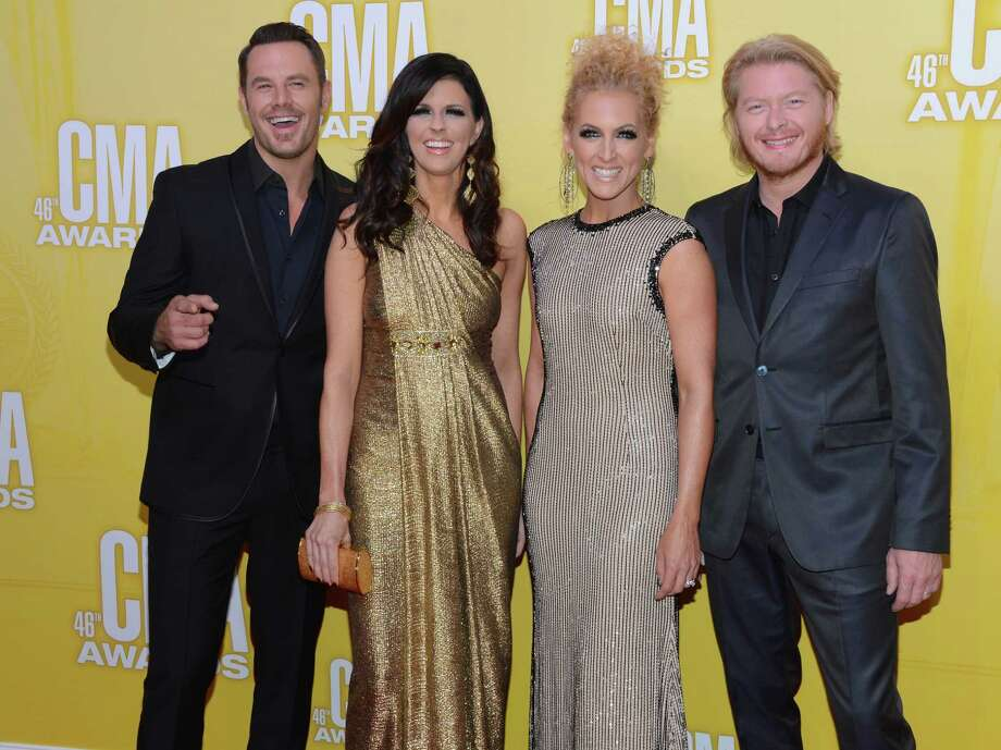 Jimi Westbrook, Karen Fairchild, Kimberly Schlapman and Phillip Sweet of Little Big Town attend the 46th annual CMA Awards at the Bridgestone Arena on November 1, 2012 in Nashville, Tennessee. Photo: Jason Kempin, Getty Images / 2012 Getty Images