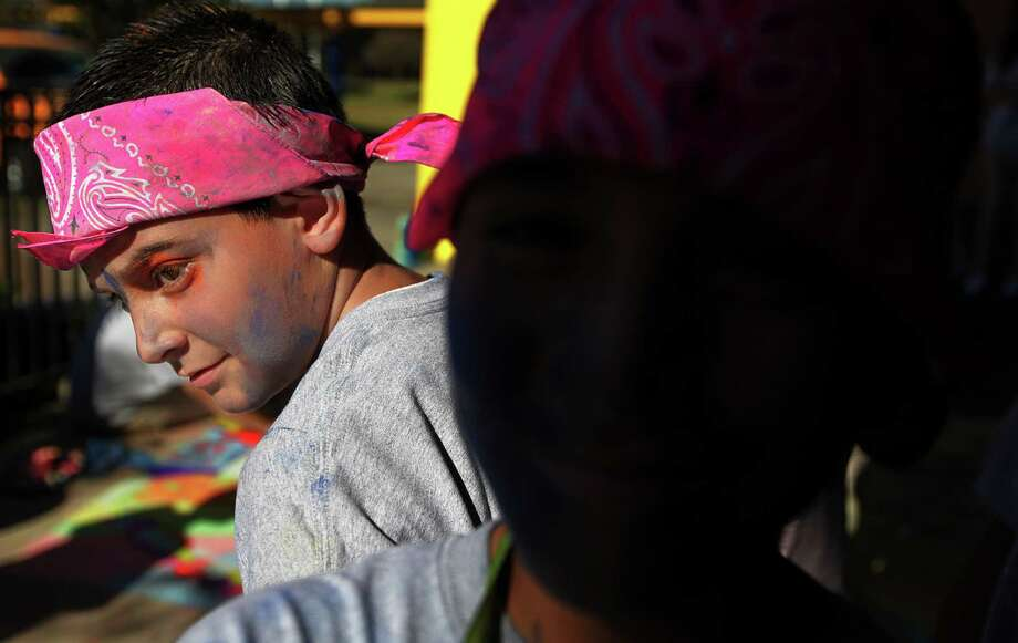 Javier Galvan, 12, and Pedro Medrano, 11, look at other designs after  completing their design in The Chalk the Walk for MS competition at Marshall Academy of Fine Arts on Thursday, Nov. 1, 2012, in Houston. Photo: Mayra Beltran, Houston Chronicle / © 2012 Houston Chronicle