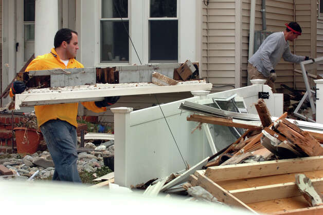 Clean up is underway from damage from Hurricane Sandy at homes along Hillside Avenue in Milford, Conn. on Thursday November 1, 2012. Photo: Christian Abraham / Connecticut Post
