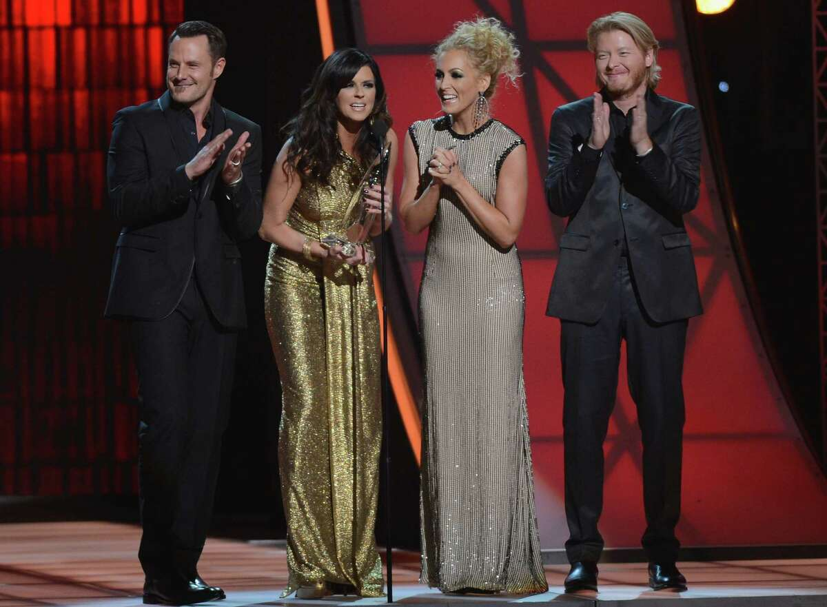NASHVILLE, TN - NOVEMBER 01: Jimi Westbrook, Karen Fairchild, Kimberly Schlapman and Phillip Sweet of Little Big Town attend the 46th annual CMA Awards at the Bridgestone Arena on November 1, 2012 in Nashville, Tennessee.