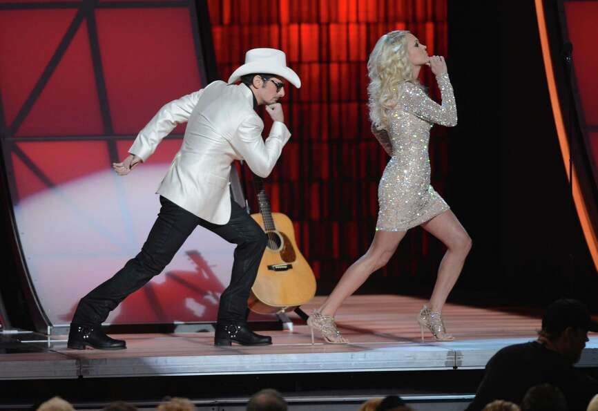 NASHVILLE, TN - NOVEMBER 01:  (L-R) Co-hosts Brad Paisley and Carrie Underwood present during the 46