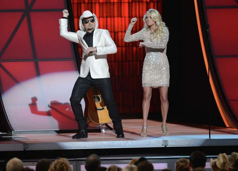 NASHVILLE, TN - NOVEMBER 01:  (L-R) Co-hosts Brad Paisley and Carrie Underwood present during the