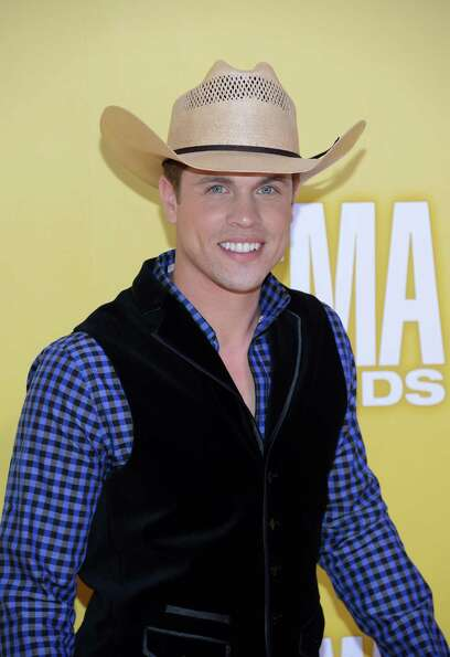 Country artist Dustin Lynch attends the 46th annual CMA Awards at the Bridgestone Arena on November