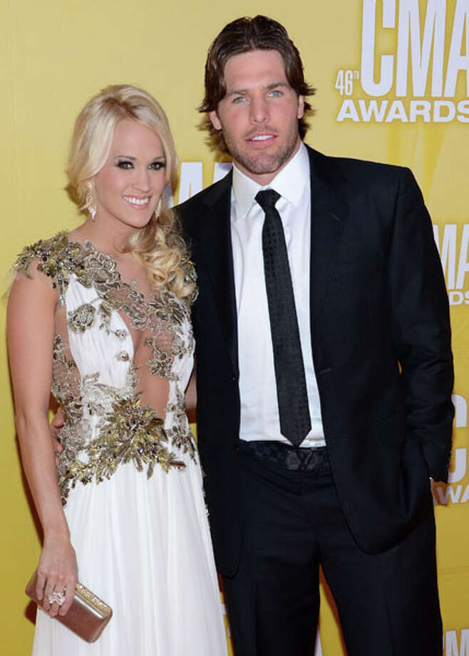 Country music artist Carrie Underwood and hockey player Mike Fisher attend the 46th annual CMA Awards at the Bridgestone Arena on November 1, 2012 in Nashville, Tennessee. Photo: Jason Kempin, Getty Images / 2012 Getty Images