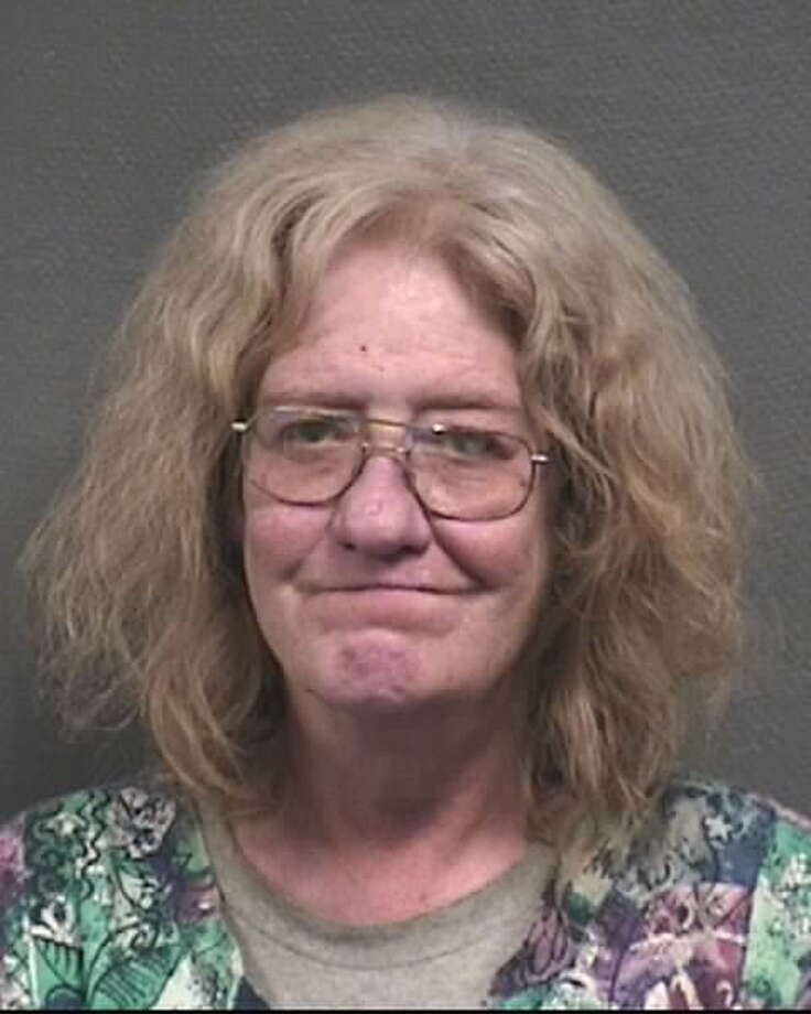 Katherine Ann Sanford, 52, allegedly struck an 11-year-old boy and a 6-year-old girl on Halloween night.  / HPD