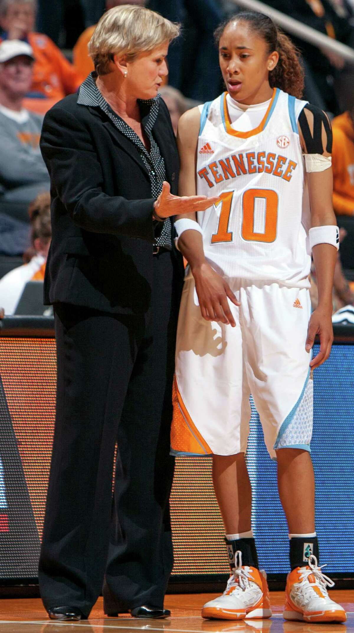 Tennessee head coach Holly Warlick talks with guard Meighan Simmons (10) during the second half of their exhibition NCAA college basketball game against Carson-Newman, Thursday, Nov. 1, 2012, in Koxville, Tenn. (AP Photo/The Knoxville News Sentinel, Adam Brimer)