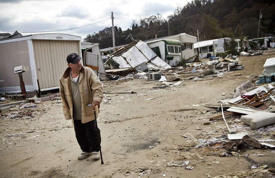 "HIGHLANDS, NJ - NOVEMBER 01:  A man who identified himself as ""Joe"" surveys the damage done to Paradise Park trailer park by Superstorm Sandy on November 1, 2012 in Highlands, New Jersey. Superstorm Sandy, which has left millions without power or water, continues to affect business and daily life throughout much of the eastern seaboard.  (Photo by Andrew Burton/Getty Images) Photo: Andrew Burton / 2012 Getty Images"