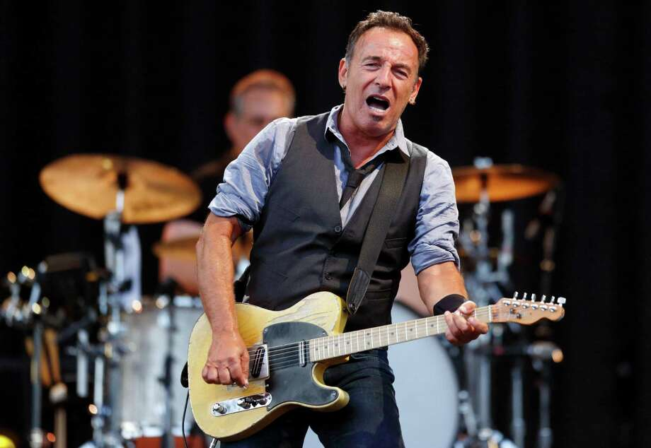 FILE - This Aug. 14, 2012 file photo shows Bruce Springsteen performing at Fenway Park in Boston. NBC is holding a benefit concert for victims of Hurricane Sandy featuring some artists native to the areas hardest hit. Bruce Springsteen and Jon Bon Jovi of New Jersey and Billy Joel of Long Island are scheduled to appear at the concert Friday, Nov. 2. (AP Photo/Michael Dwyer, file) Photo: Michael Dwyer
