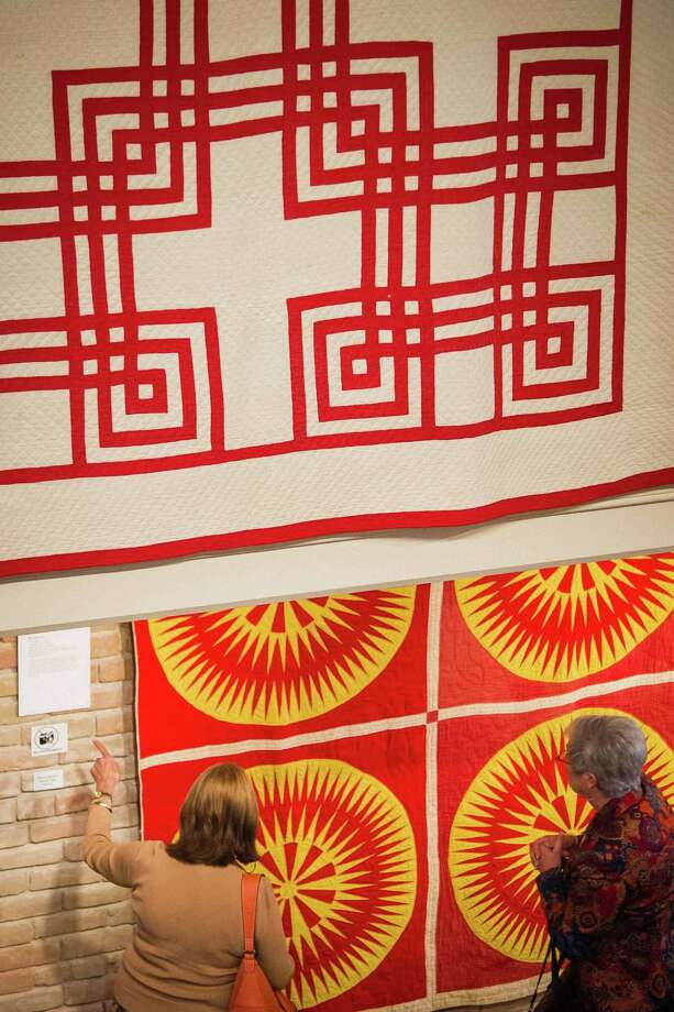 Visitors look at a quilt at the Texas Quilt Museum, Friday, Oct. 26, 2012, in La Grange. Photo: Michael Paulsen, Houston Chronicle / © 2012 Houston Chronicle