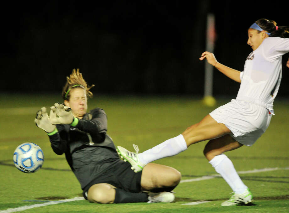 Western's Tracy Sales shoots on Souther Maine goalie Katie Cobb during their Little East Conference quarterfinal game at Western Connecticut State University's westside campus in Danbury on Thursday, Nov. 1, 2012. Western won 2-0. Photo: Jason Rearick / The News-Times
