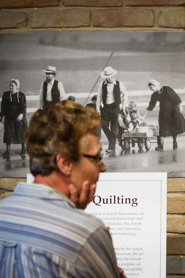 Judy Chovanec looks at the selection of quilts at the Texas Quilt Museum, Friday, Oct. 26, 2012, in La Grange. Photo: Michael Paulsen, Houston Chronicle / © 2012 Houston Chronicle