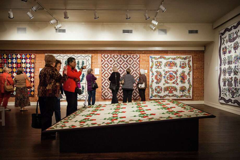 Jeanne Broussard, left to right, Connie McGown and Sylvie Belgrove look at a stuffed applique quilt from 1855 along with other visitors from Pearl Fincher Museum of Fine Arts at the Texas Quilt Museum, Friday, Oct. 26, 2012, in La Grange. Photo: Michael Paulsen, Houston Chronicle / © 2012 Houston Chronicle