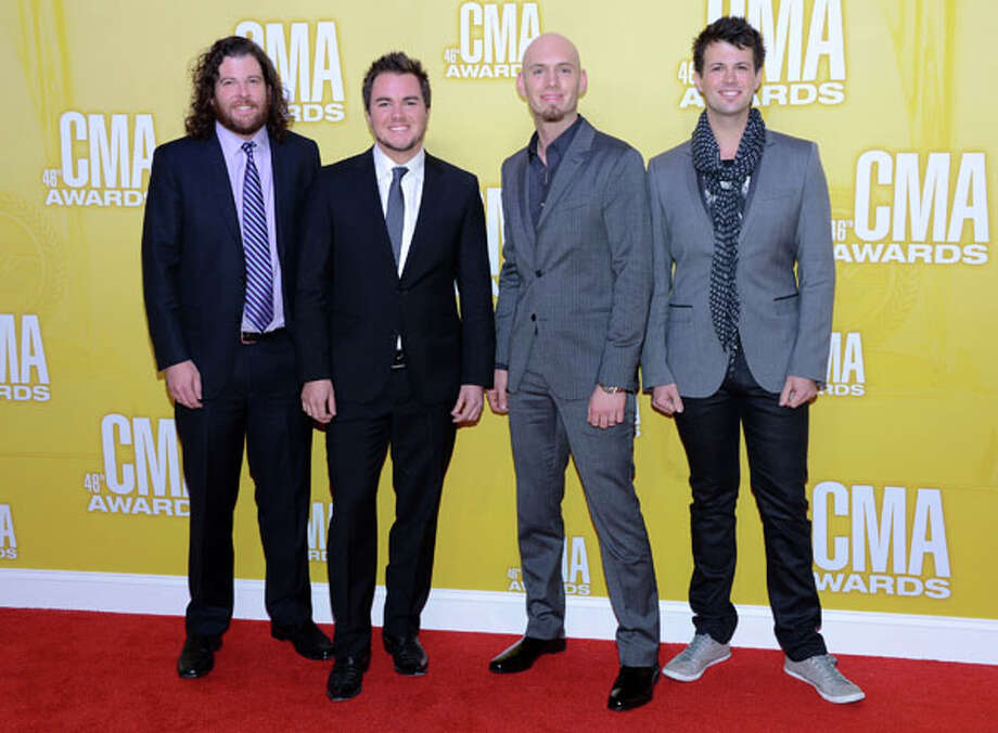(L-R) James Young, Mike Eli, Jon Jones, and Chris Thompson of Eli Young Band attend the 46th annual CMA Awards at the Bridgestone Arena on November 1, 2012 in Nashville, Tennessee. Photo: Jason Kempin, Getty Images / 2012 Getty Images