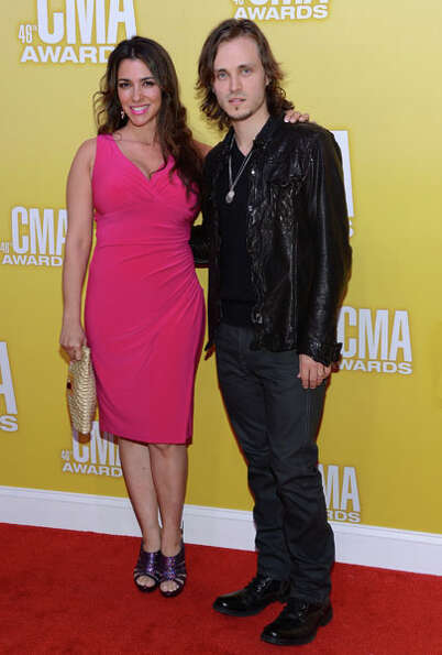 Actors Jonathan Jackson (R) and Lisa Vultaggio attend the 46th annual CMA Awards at the Bridgestone