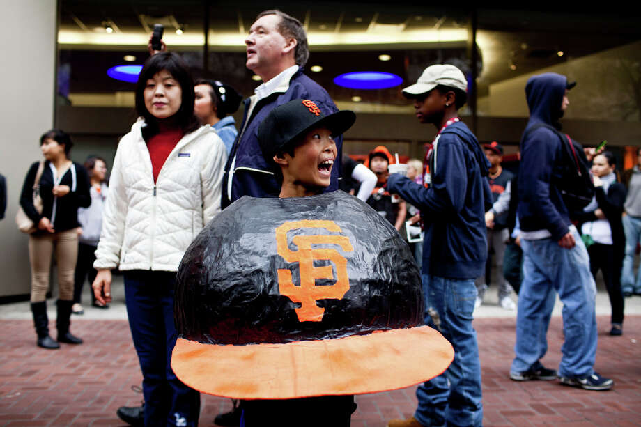 Ryan Eyee, 10, wore this papier-m‰acheŽ Giants hat during the team's World Series Championship parade in San Francisco on Wednesday, October 31, 2012. Many fans came dressed in costume for the Halloween parade, here are some of our favorites. Photo: Jason Henry, Special To The Chronicle / ONLINE_YES