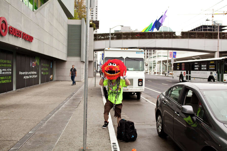 Seth Tate, dressed as Animal from The Muppets, was dropped off near the parade. Photo: Jason Henry, Special To The Chronicle / ONLINE_YES