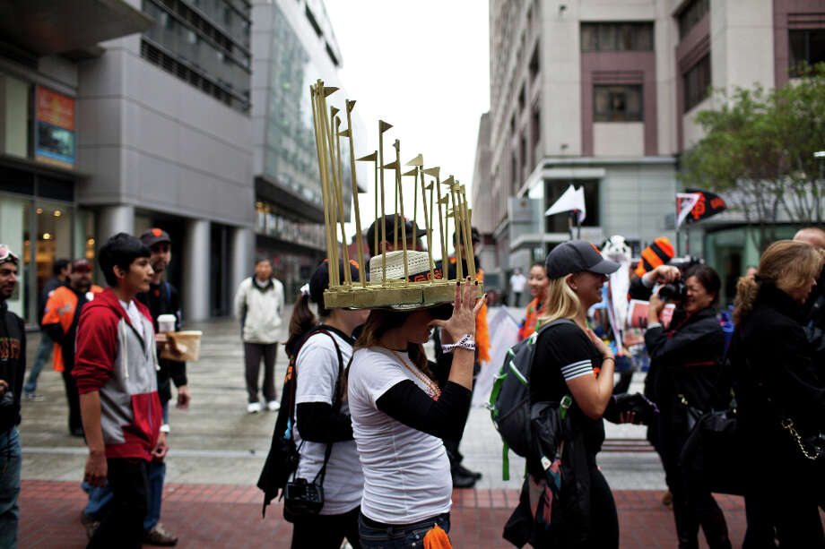 Many fans wore trophy-themed outfits. Megan Hurley wore a trophy hat to the parade. Photo: Jason Henry, Special To The Chronicle / ONLINE_YES