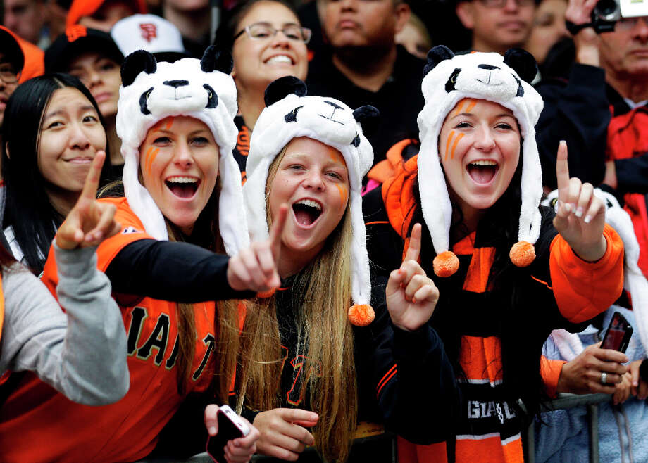 Giants fans Alison Griffith, Katie Peck and Beth Giotta showed their Panda support. Photo: Marcio Jose Sanchez, Associated Press / AP