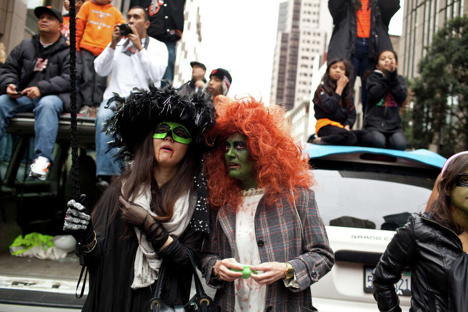 Loren Biac, dressed as the girl from the movie The Excorsist, and Izumi Miura, dressed as a witch, enjoyed the parade. Photo: Jason Henry, Special To The Chronicle / ONLINE_YES
