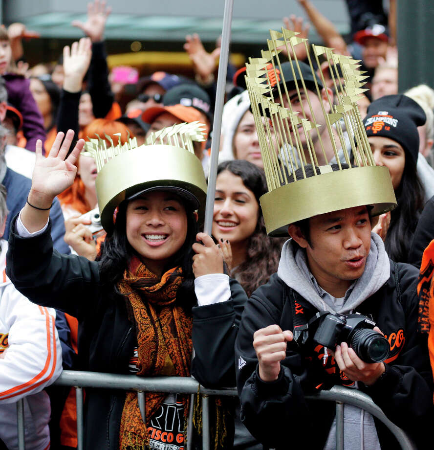 Fans Elizabeth Santos, left, and Joseph Foranda went the matching trophy-hat route. Photo: Sanchez, Associated Press / AP