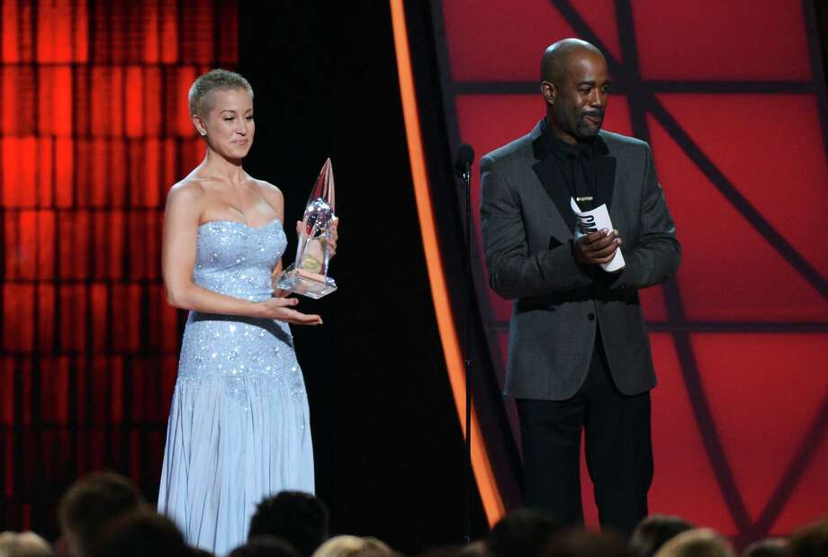 NASHVILLE, TN - NOVEMBER 01:  Kellie Pickler and Darius Rucker speak onstage during the 46th annual CMA Awards at the Bridgestone Arena on November 1, 2012 in Nashville, Tennessee. Photo: Jason Kempin, Getty Images / 2012 Getty Images