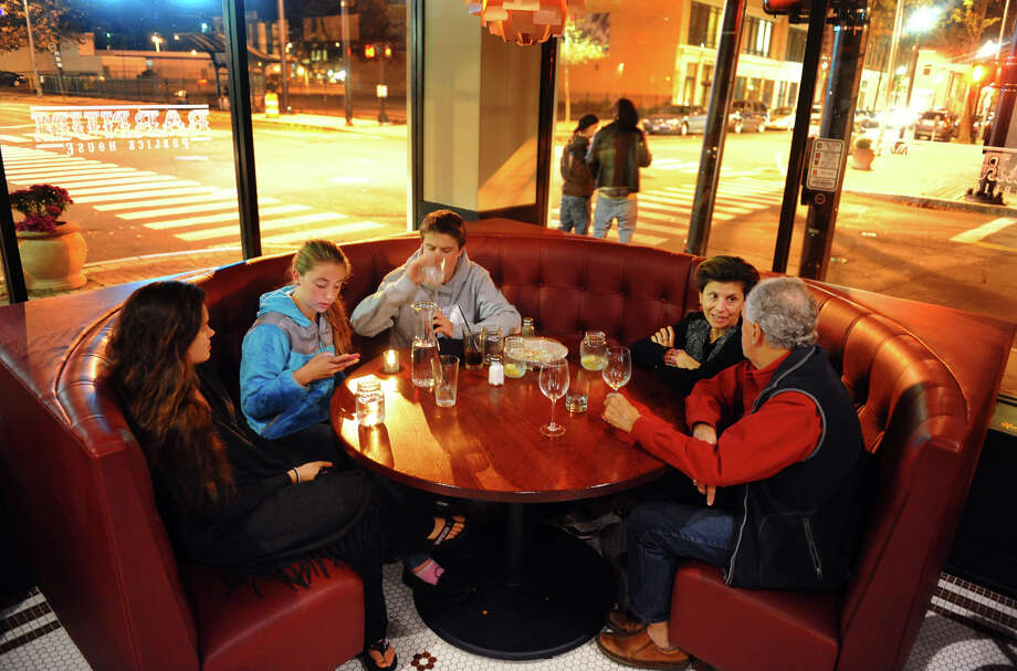 Since many places still have no power because of Hurricane Sandy, people have been gathering at hot spots like Barnum Public House in downtown Bridgeport, Conn. on Thursday November 1, 2012. Enjoying an evening out are Bridgeport residents (L to R) Emma Speer, Gigi Speer, James Speer, their mom Claire Mastromonaco, and step father Ralph Venturini. Photo: Christian Abraham / Connecticut Post