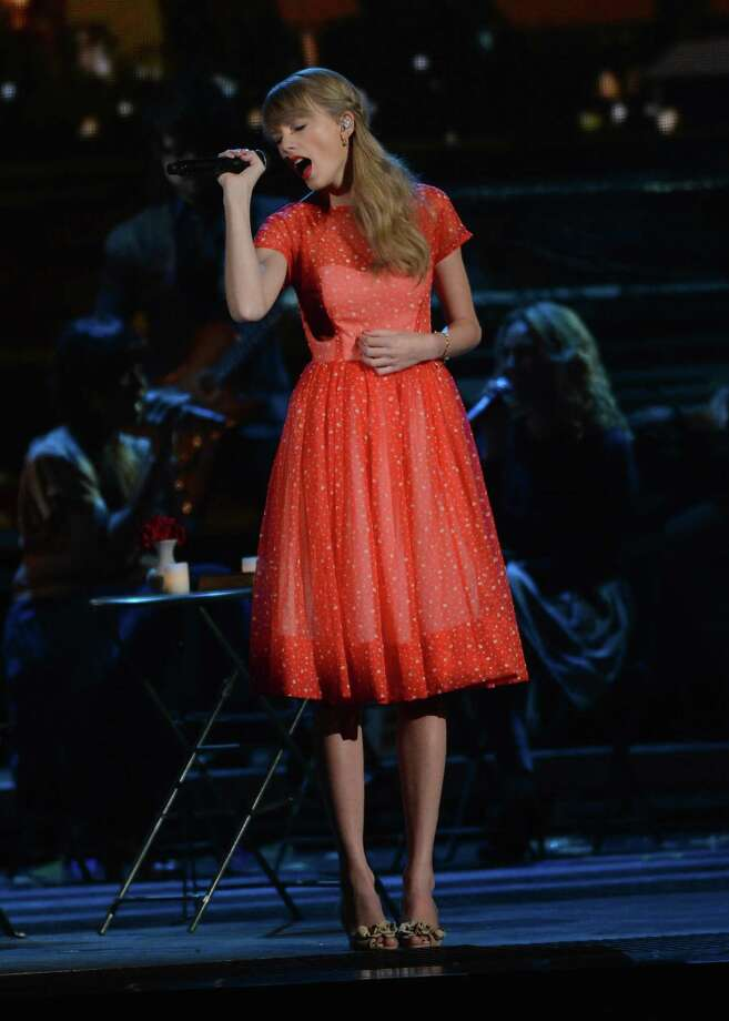 NASHVILLE, TN - NOVEMBER 01: Taylor Swift performs during the 46th annual CMA Awards at the Bridgestone Arena on November 1, 2012 in Nashville, Tennessee. Photo: Jason Kempin, Getty Images / 2012 Getty Images