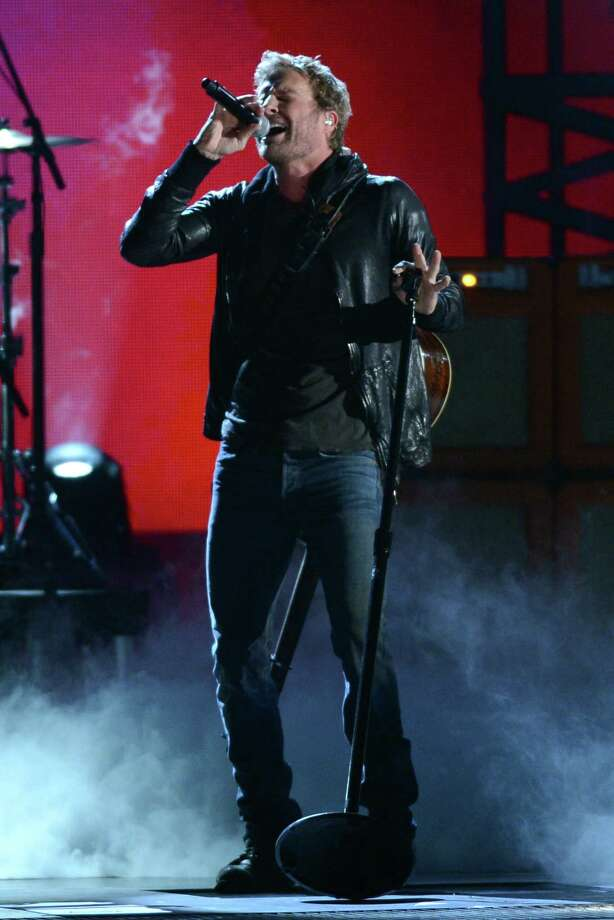 NASHVILLE, TN - NOVEMBER 01:  Dierks Bentley performs during the 46th annual CMA awards at the Bridgestone Arena on November 1, 2012 in Nashville, United States. Photo: Jason Kempin, Getty Images / 2012 Getty Images