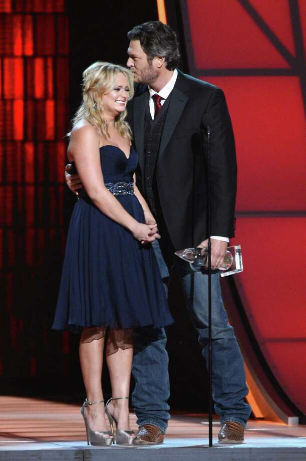 NASHVILLE, TN - NOVEMBER 01:  Miranda Lambert (L) and Blake Shelton speak onstage during the 46th annual CMA Awards at the Bridgestone Arena on November 1, 2012 in Nashville, Tennessee. Photo: Jason Kempin, Getty Images / 2012 Getty Images