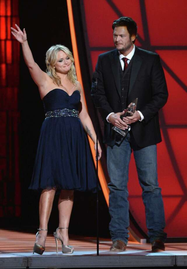 NASHVILLE, TN - NOVEMBER 01:  Miranda Lambert and Blake Shelton accept an award onstage during the 46th annual CMA Awards at the Bridgestone Arena on November 1, 2012 in Nashville, Tennessee. Photo: Jason Kempin, Getty Images / 2012 Getty Images